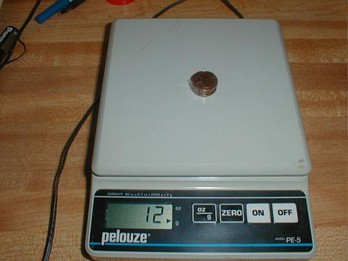 5 pennies on the scale weigh 12 g